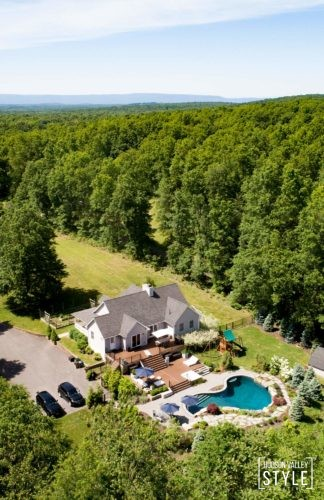 A beautiful Hudson valley Home for Sale with a heated pool, jacuzzi, 4 acres of private ATV and hiking trails and amazing modern rustic kitchen