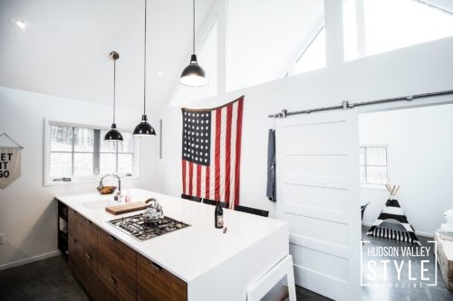 Pendant lights, white walls, american flag, white countertops
